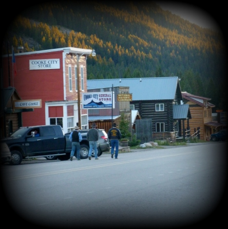 Note the 3 men in cowboys boots & hats.  This is Main Street (basically the ONLY street) of Cooke City, MT, just outside the NE entrance of Yellowstone NP.