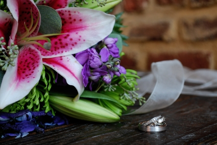 Our wedding rings with my bouquet, designed by the florist my husband worked for in high school .  Photo by Triskay Photography.