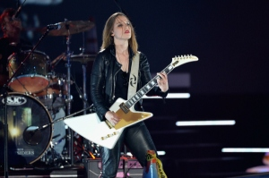 Lzzy Hale has certainly become a sex symbol in the rock community & one can easily see why.  But that isn't why she's famous.  She's famous b/c she is an insanely talented singer & guitarist . . . who just happens to be pretty hot too. :)