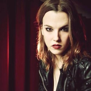 Lzzy Hale is definitely a role model for me in some ways. She's gorgeous & feminine in some ways but also a total badass.