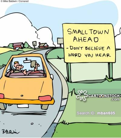 Sign reads: 'Small town ahead - don't believe a word you heard.'